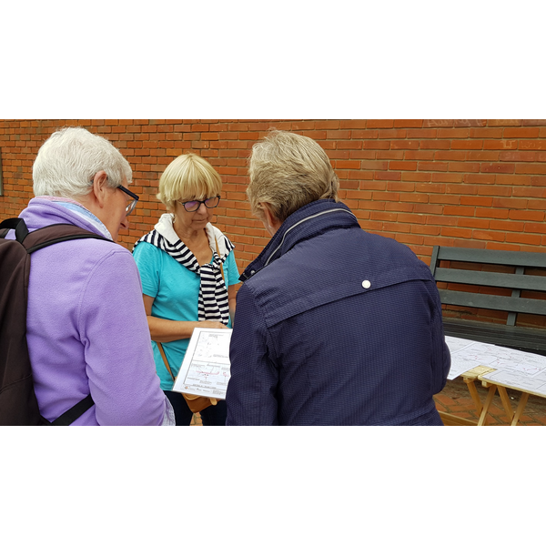 Cllrs Ackroyd and Lubbock speaking with a local resident at the Bank Holiday Monday street surgery